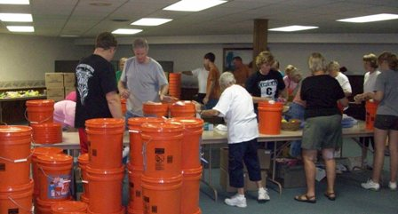 Camp Point UMC assembling flood buckets during its Mission Extravaganza June 19