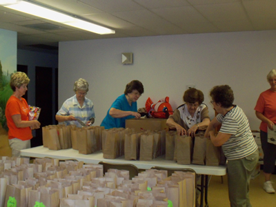 Volunteers from Girard and Virden UMCs assemble goodie bags
