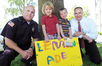 Mattoon Police Department patrol officer Kasey Alexander, lemonade stand proprietors Jack Lapeyrouse and Jacob Zike and Mattoon Police Department Deputy Chief Jason Taylor,
