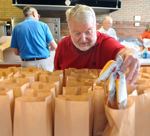Volunteers prepare sack lunches at Danville St. James UMC