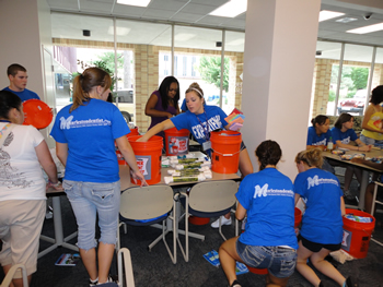 EIU students assemble flood buckets as part of the school's Jumpstart to GIVE