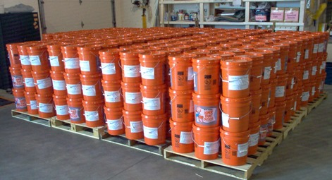 The flood buckets on pallets in the Midwest Mission Distribution Center