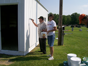 John Macke and Sally Mallory paint the Marshall Cemetery Office