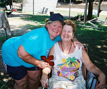 East Alton First UMC volunteer Dianna Meyer with Delhi, Iowa resident Jean during the church's mission trip to the flood-ravaged community.