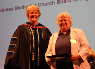 Dr. Christine Bahr, McKendree University provost and dean, presents the 2012 United Methodist Church Exemplary Teacher Award to Dr. Martha McDonald, associate professor of nursing, on Honors Day.