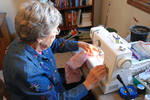 Bernice Stropes at her sewing machine
