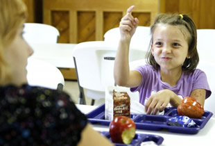 Journey Banks enjoys her meal at Herrin First UMC's Summer Lunch program