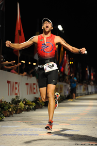 Roy Riley finishing the Ironman Triathlon