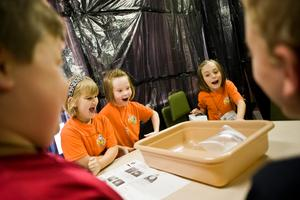 Bible School students react to a science experiment that is part of Galactic Blast VBS.