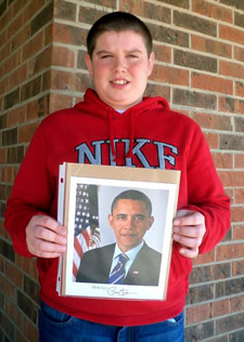 Alec Lester holds letter from President Obama